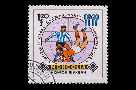 Novosibirsk, Russia - January 07, 2020: stamp printed in  Mongolia shows how football players play football, a postage stamp in honor of the 1978 WORLD FOOTBALL CHAMPIONSHIP in Argentina Редакционное