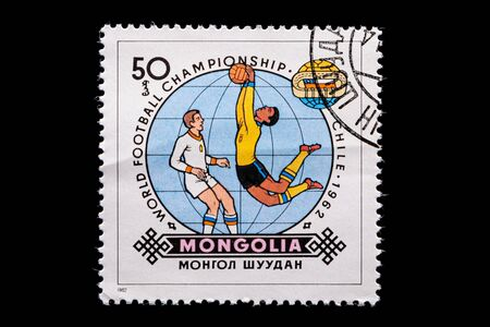 Novosibirsk, Russia - January 07, 2020: stamp printed in  Mongolia shows how football players play football, a postage stamp in honor of the 1962 WORLD FOOTBALL CHAMPIONSHIP in Chile