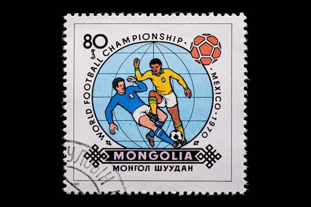 Novosibirsk, Russia - January 07, 2020: stamp printed in  Mongolia shows how football players play football, a postage stamp in honor of the 1970 WORLD FOOTBALL CHAMPIONSHIP in Mexico Редакционное