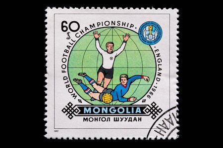 Novosibirsk, Russia - January 07, 2020: stamp printed in Mongolia shows how football player play football, a postage stamp in honor of the 1966 soccer championship in England