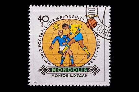 Novosibirsk, Russia - January 07, 2020: stamp printed in Mongolia shows how football player play football, a postage stamp in honor of the 1958 soccer championship in Sweden