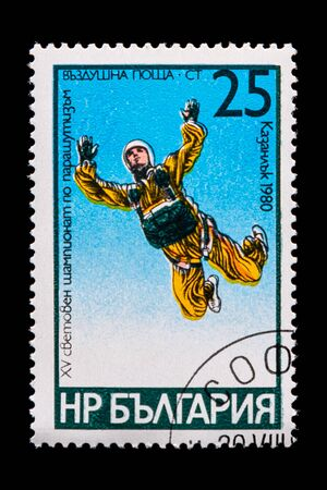 Novosibirsk, Russia - January 07, 2020: stamp printed in Bulgary shows how man parachute jumping from below, circa 1980