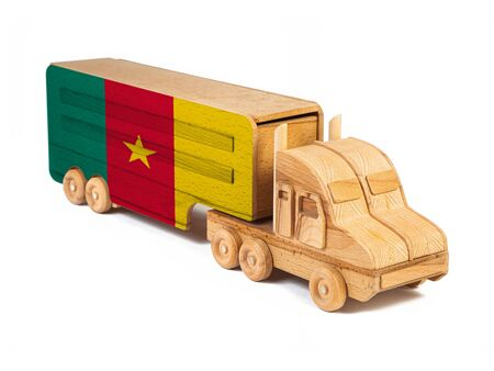 Close-up of a wooden toy truck with a painted national flag Cameroon. The concept of export-import,transportation, national delivery of goods