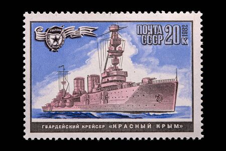 """Novosibirsk, Russia - January 07, 2020: stamp printed in USSR shows guards cruiser """"Red Crimea"""". A postage stamp circa 1982"""