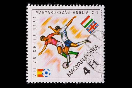 Novosibirsk, Russia - January 07, 2020: stamp printed in Bulgaria shows how football players Hungary and England  play football, a postage stamp in honor of the 1962 world championship in Chile 新聞圖片