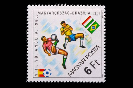 Novosibirsk, Russia - January 07, 2020: stamp printed in Bulgaria shows how football players Hungary and Brazil play football, a postage stamp in honor of the 1966 world championship in England 新聞圖片
