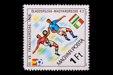 Novosibirsk, Russia - January 07, 2020: stamp printed in Bulgaria shows how football players Hungary and Italy  play football, a postage stamp in honor of the 1938 world championship in France
