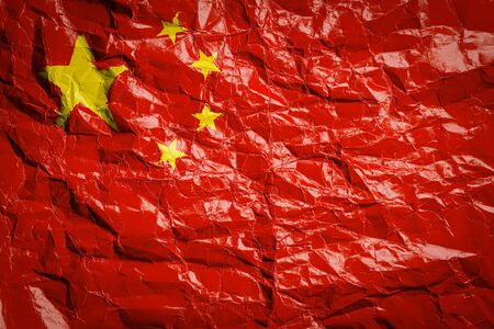 National flag of China on crumpled paper. Flag printed on a sheet. Flag image for design on flyers, advertising. Stock Photo
