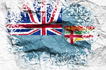 The national flag of the Fiji  is painted on crumpled paper. Flag printed on the sheet. Flag image for design on flyers, advertising. Stock Photo