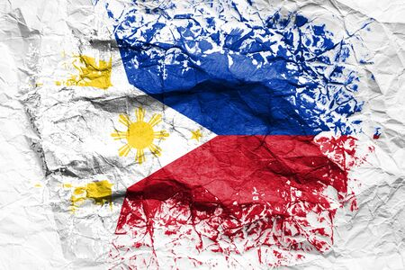 The national flag of the Philippines is painted on crumpled paper. Flag printed on the sheet. Flag image for design on flyers, advertising.