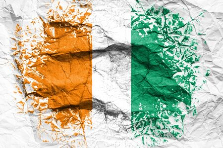 The national flag of the Cote d'ivoire is painted on crumpled paper. Flag printed on the sheet. Flag image for design on flyers, advertising.