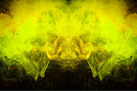 Fog colored with bright  yellow  smoke on dark background. Background consists of fractal multicolor texture and is suitable for use in projects on imagination, creativity and design.