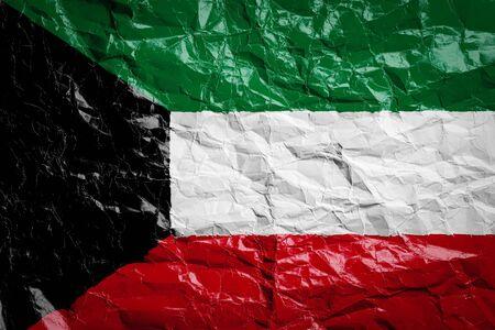 National flag of Kuwait on crumpled paper. Flag printed on a sheet. Flag image for design on flyers, advertising. Reklamní fotografie