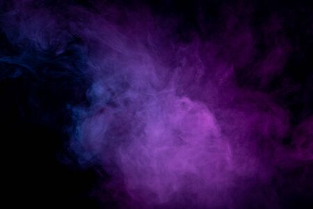 Cloud of purple and pink smoke  in the form of a skull, monster, dragon  on a black isolated background. Background from the smoke of vape.