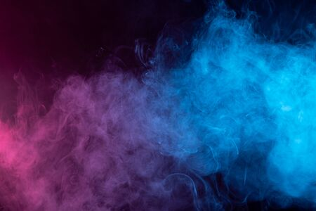 Toxic movement of color smoke abstract on black background, fire design. Fantasy blue and red smoke abstract on black background.