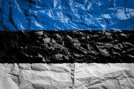 National flag of Estonia on crumpled paper. Flag printed on a sheet. Flag image for design on flyers, advertising.