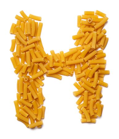 Letter H of the English alphabet from dry pasta on a white isolated background. Food pattern made from makaroni tubes. Bright alphabet for shops.