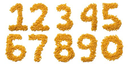 Arabic numerals  from dry pasta on a white isolated background. Food pattern made from macaroni tubes. Bright alphabet for shops.