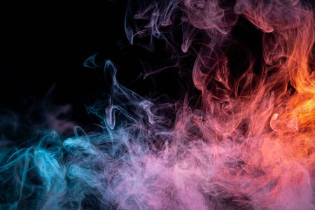Red and  blue  cloud smoke on black  isolated background. Fog colored with bright pink gel on dark background Фото со стока