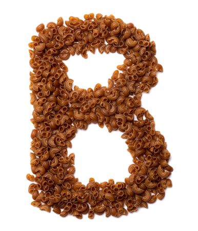 Letter B of the English alphabet from dry pasta from buckwheat amaranth flour on a white isolated background. Food pattern made from macaroni tubes. Bright alphabet for shops.