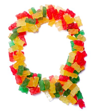 Letter Q of the English alphabet from multi-colored chewing marmalade on a white isolated background. Food pattern made ffrom children's sweets bears. Bright alphabet for kids design