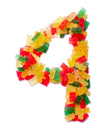Arabic numeral 4  from multi-colored chewing marmalade on a white isolated background. Food pattern made ffrom childrens sweets bears. Bright alphabet for kids design