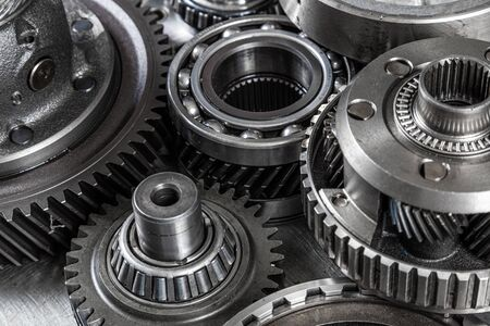 Close-up of an important spare part of a car gearbox. Glossy metal gear for planetary gearbox. Metal autotechnology background, silver metallic with gears inside. Stock Photo
