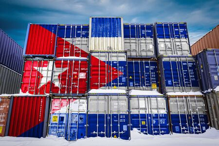 The national flag of Cuba on a large number of metal containers for storing goods stacked in rows on top of each other. Conception of storage of goods by importers, exporters