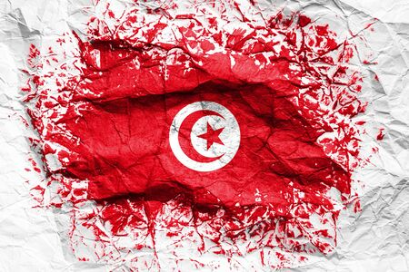 The national flag of the Tunisia is painted on crumpled paper. Flag printed on the sheet. Flag image for design on flyers, advertising.