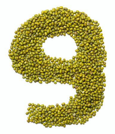 "Arabic numeral ""9"" from green mung bean on a white isolated background. Food pattern made from mung. Bright alphabet for shops."