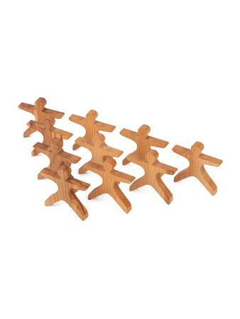 Close-up of a children's toy made of natural wood in the form of little people stand pyramid on a white isolated background. Eco-friendly toy for parents and children