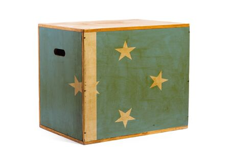A wooden box for reliable shipment of various goods and cargo with the national flag of Federal States of Micronesia on a white isolated background. The concept of export-import and national delivery of goods. Stock Photo