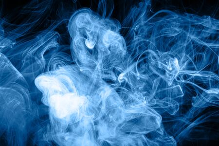 Colorful blue smoke  on a black isolated background. Background from the smoke of vape