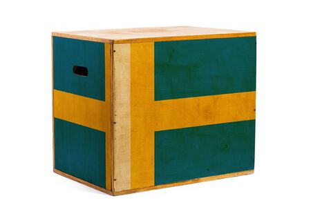 A wooden box for reliable shipment of various goods and cargo with the national flag of Sweden on a white isolated background. The concept of export-import and national delivery of goods.