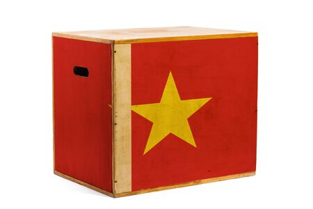 A wooden box for reliable shipment of various goods and cargo with the national flag of Vietnam on a white isolated background. The concept of export-import and national delivery of goods.