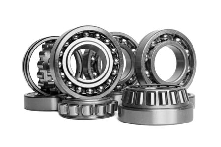 Set of various roller bearing on white background isolated. Metal autotechnology background. Part of the car Stock Photo
