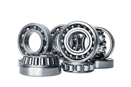Set of various roller bearing on white background isolated. Metal autotechnology background. Part of the car Banque d'images