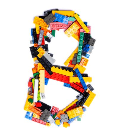 """Arabic numeral """"8"""" from multi-colored children's plastic constructor on a white isolated background. Bright alphabet for kids design"""