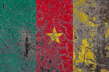 National flag of Cameroon on old peeling wall background.The concept of national pride and symbol of the country. Imagens