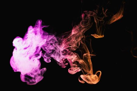 Smoke of pattern pink and red on a dark isolated background. Scary and mysterious symbol
