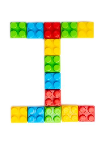 Letter I of the English alphabet  from multi-colored children's plastic constructor on a white isolated background.  Bright alphabet for kids design