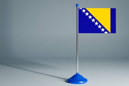 The 3d rendering  realistic national flag of Barbados on steel pole on gray isolated background.  Blank table flag , suitable for design, mockup 版權商用圖片