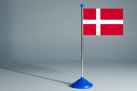 The 3d rendering  realistic national flag of Denmark on steel pole on gray isolated background.  Blank table flag , suitable for design, mockup