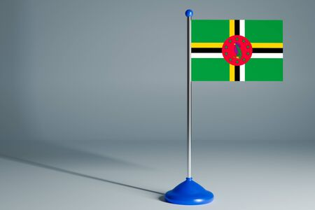 The 3d rendering  realistic national flag of Dominica on steel pole on gray isolated background.  Blank table flag , suitable for design, mockup 版權商用圖片