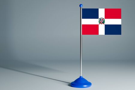 The 3d rendering  realistic national flag of Dominicana on steel pole on gray isolated background.  Blank table flag , suitable for design, mockup