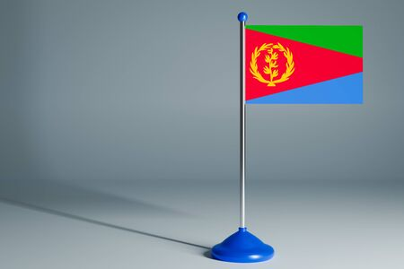 The 3d rendering  realistic national flag of Eritrea on steel pole on gray isolated background.  Blank table flag , suitable for design, mockup