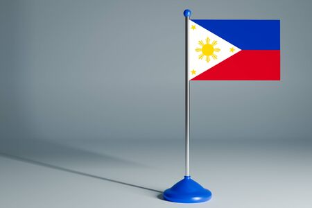 The 3d rendering  realistic national flag of Philippines on steel pole on gray isolated background.  Blank table flag , suitable for design, mockup 版權商用圖片