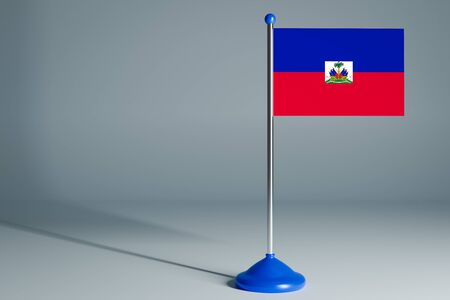 The 3d rendering  realistic national flag of Haiti on steel pole on gray isolated background.  Blank table flag , suitable for design, mockup