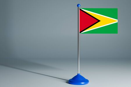 The 3d rendering  realistic national flag of Guyana on steel pole on gray isolated background.  Blank table flag , suitable for design, mockup
