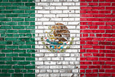 National flag of Mexico depicting in paint colors on an old brick wall. Flag  banner on brick wall background. 版權商用圖片